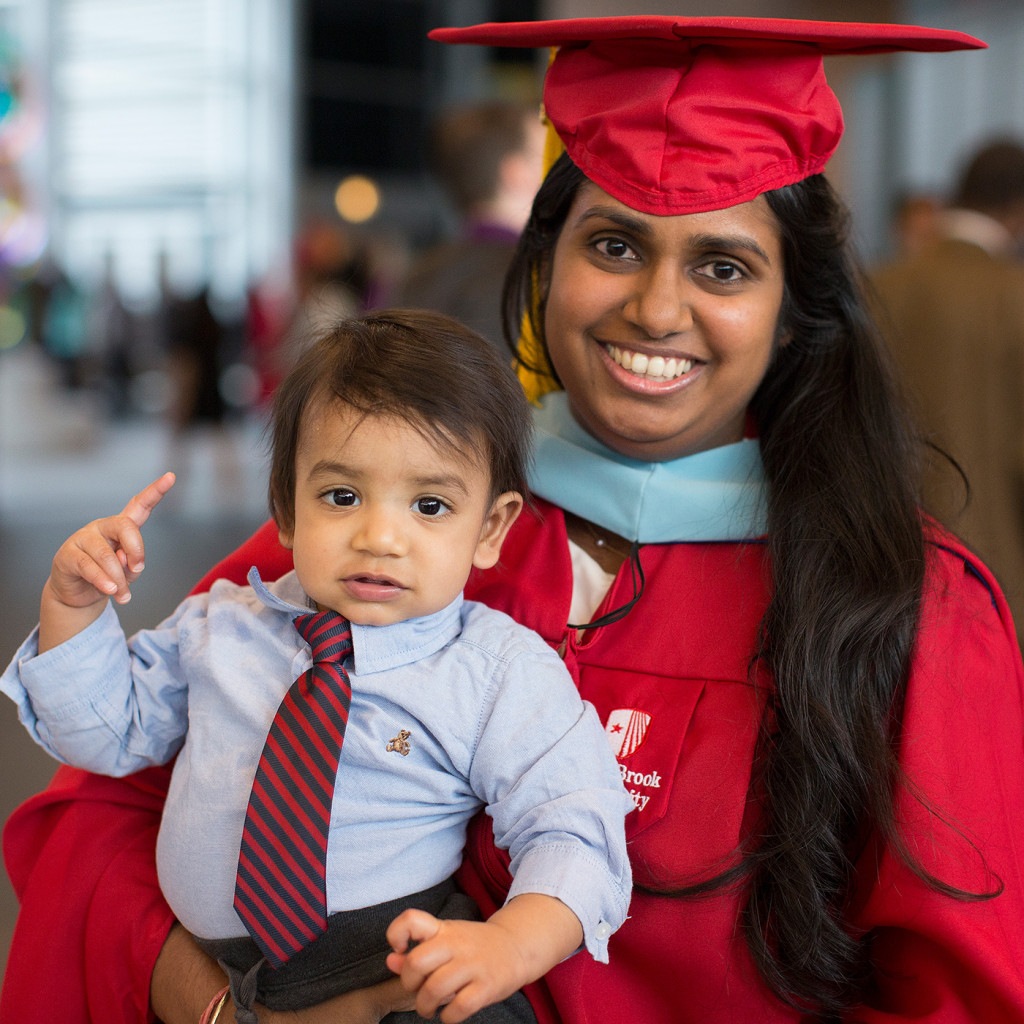 My little guy pointing out that Lakshmi is in fact #1 after graduating in May with her second master's degree from Stony Brook University.