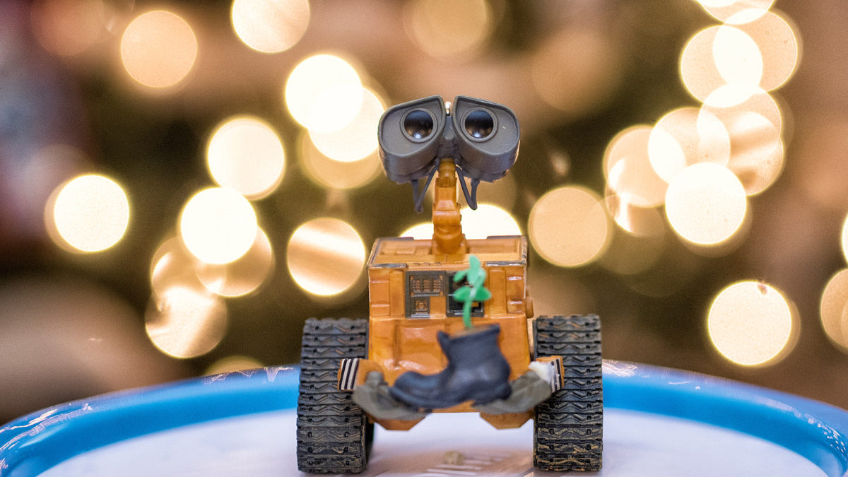 Christmas lights behind a Wall-E ornament.